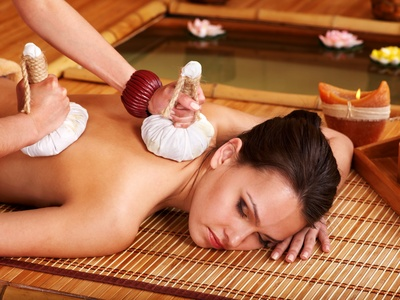 Thai massage with  herbal compress, perfect for shoulder pain